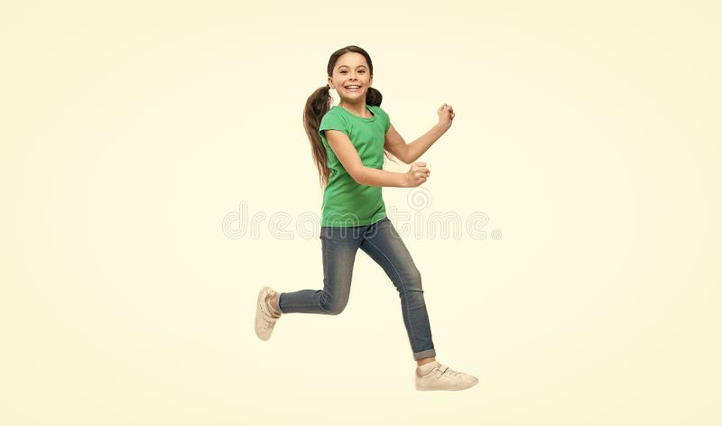 Kid captured in motion. How raise active kid. Free and full of energy. Rules to keep kids active. Girl cute child with royalty free stock photography