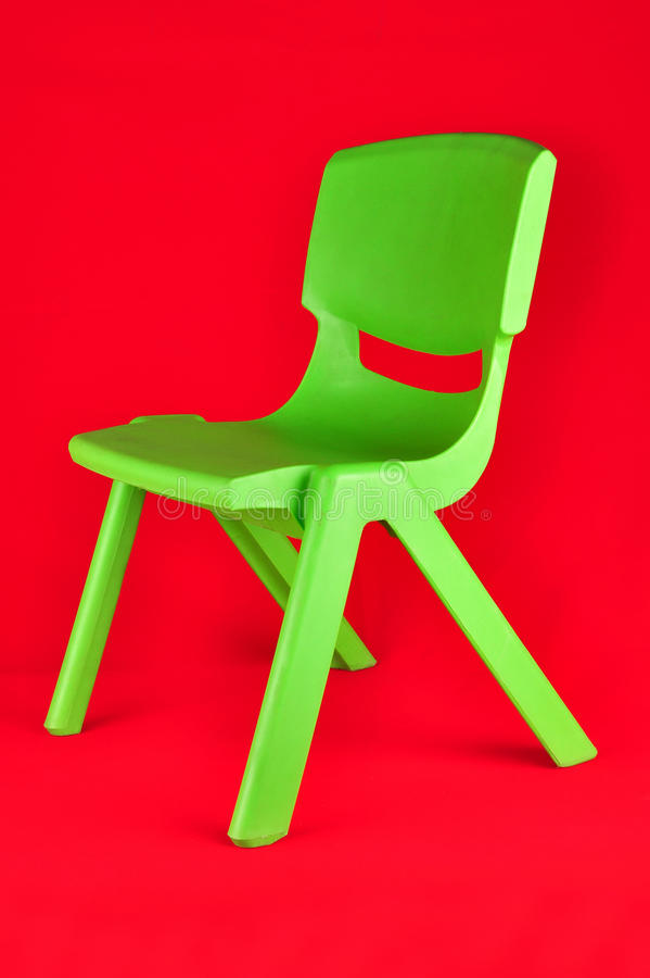 Kid chair. A kid chair isolated on red stock photography