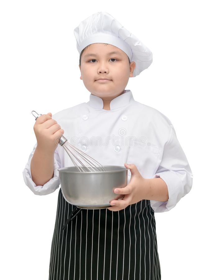 Kid chef hold whisk with cook hat and apron stock photography