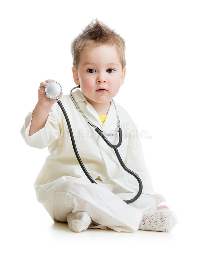 Kid or child playing doctor with stethoscope royalty free stock images