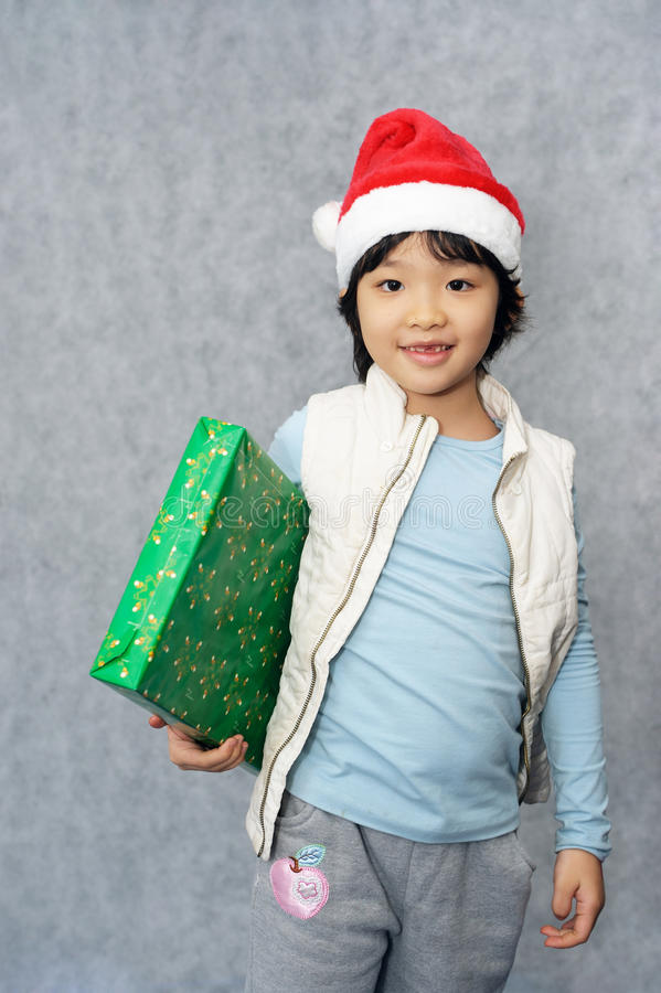 Kid with Christmas gift royalty free stock photo