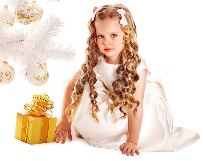 Kid with Christmas gift box. royalty free stock photos