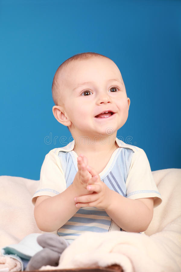 Kid claps and smiles royalty free stock images