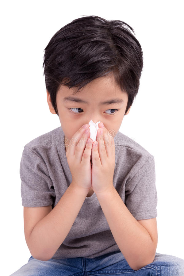 Kid cleaning nose with tissue royalty free stock photography