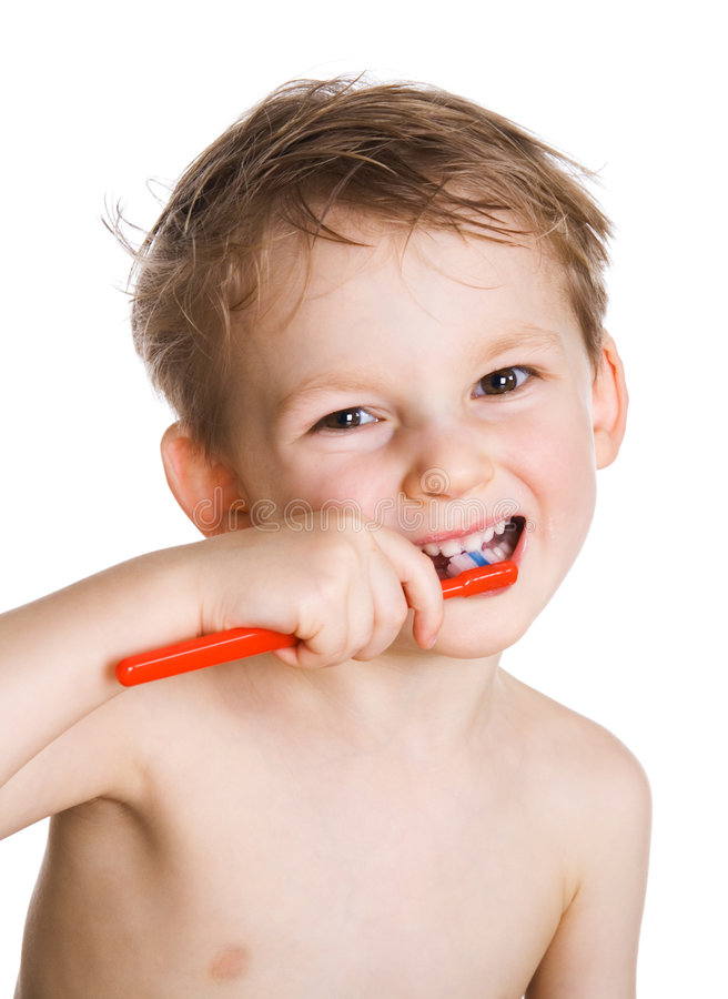 Kid Cleans A Teeth Royalty Free Stock Images