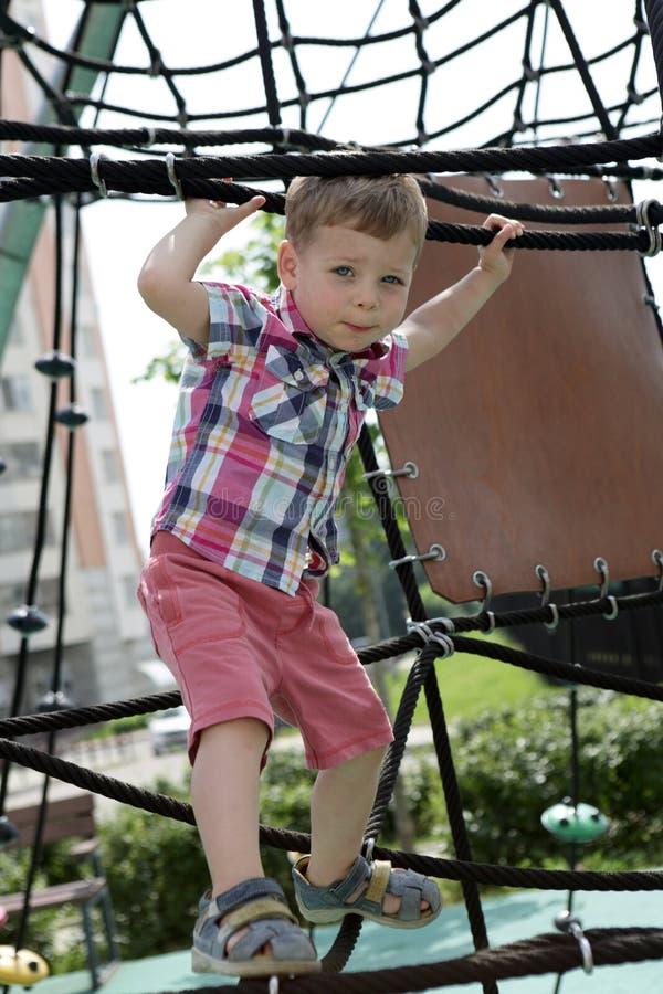 Kid on climbing net royalty free stock image