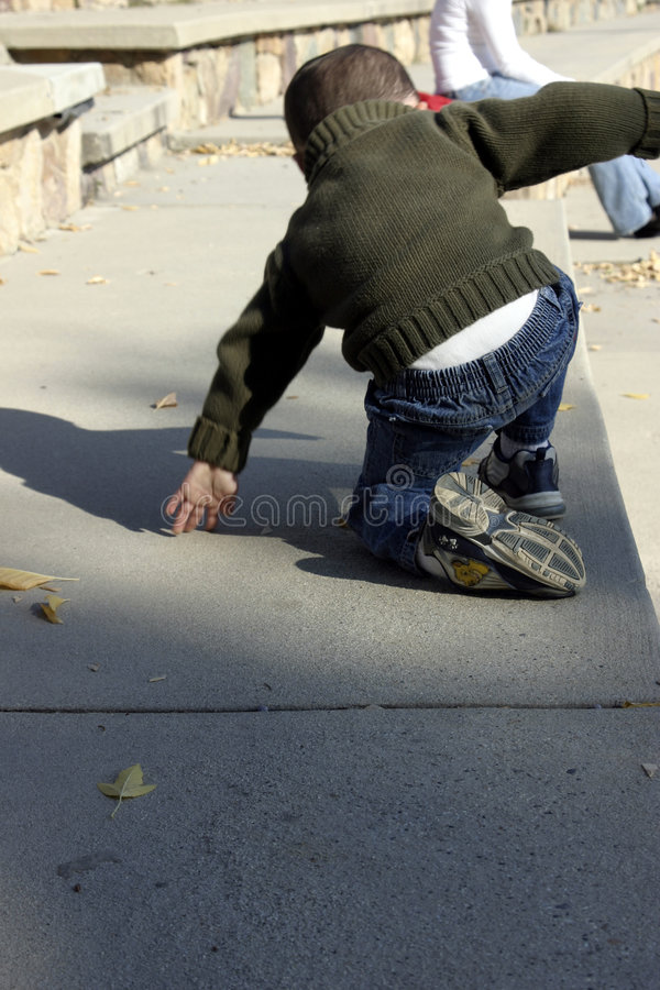 Kid Climbing Up royalty free stock photos