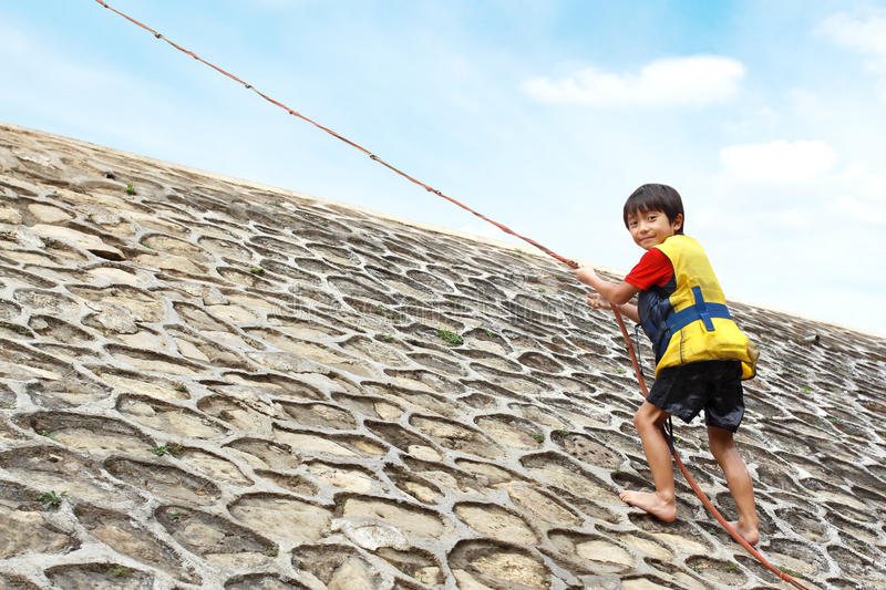Download Kid climbing using rope stock image. Image of confidence - 25856399