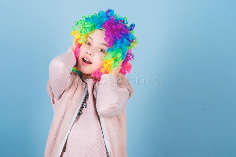 Kid colorful curly wig artificial hair clown style blue background. Circus school concept. Acting school for children stock photos