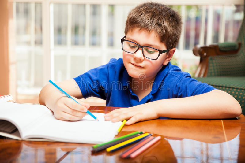 Kid coloring some drawings royalty free stock photo