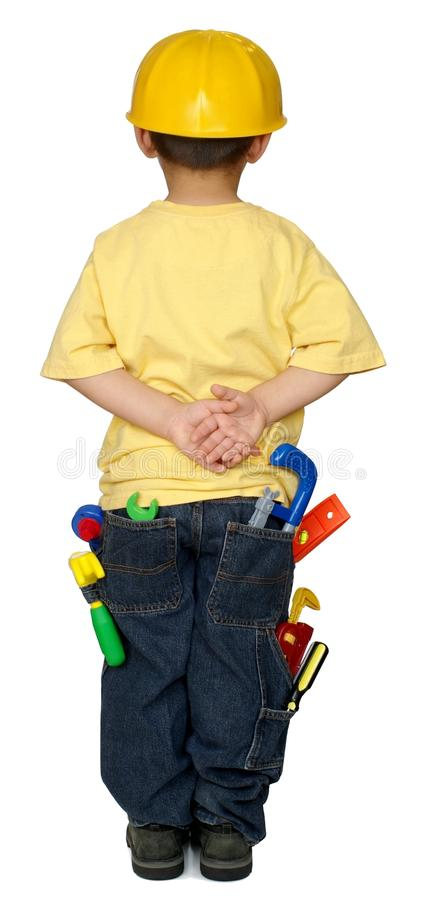 Kid with construction tools royalty free stock photos