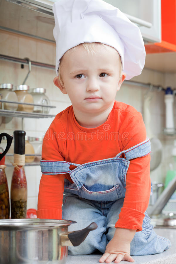 Kid In A Cook Cap Royalty Free Stock Image