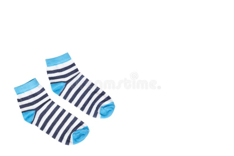 Kid cotton socks, striped texture. Isolated on white background, copy space template royalty free stock photos