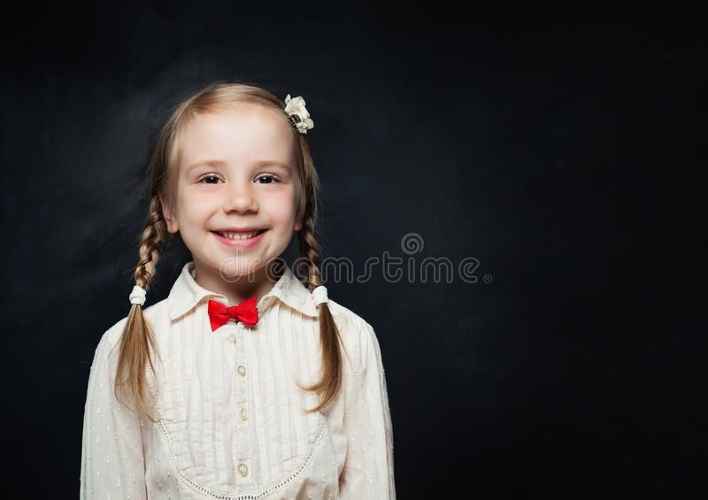 Kid Creativity Education Concept. Happy Child Girl. On Black Chalk Board with Copy space. Back to school royalty free stock images