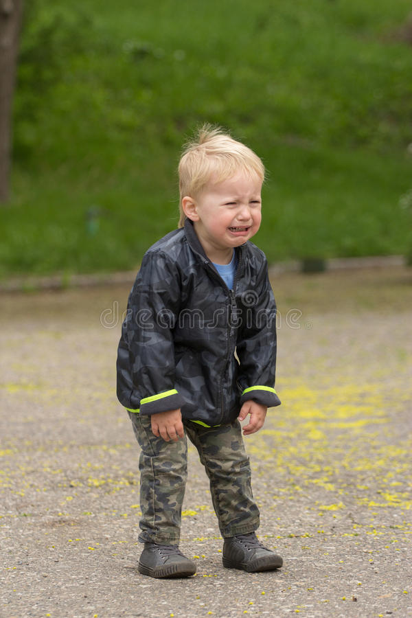 Kid crying very loud stock images