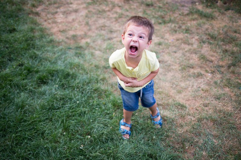 Kid crying very loud in a temper tantrum royalty free stock photos