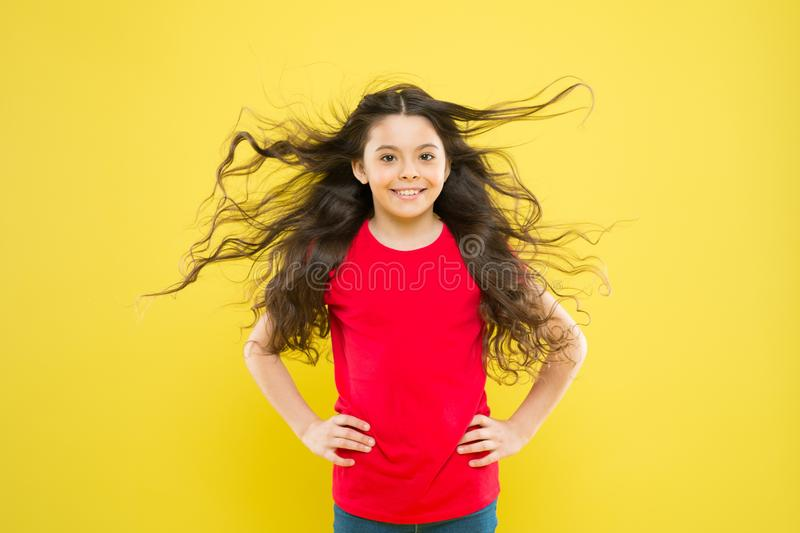 Kid cute face with adorable curly hairstyle. Little girl grow long hair. Teen fashion model. Discover difference. Styling curly hair. Hairdresser tip. Kid girl stock image