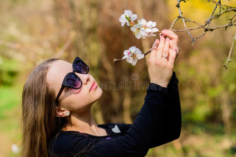 Kid cute fancy child spend time in park. Plants grown for display to public. Pleasant relaxing walk in garden. Girl walk stock images