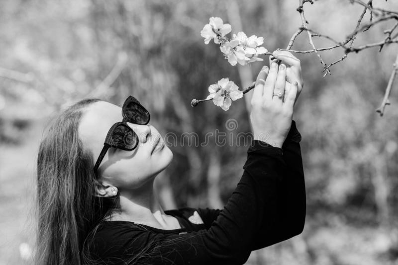 Kid cute fancy child spend time in park. Plants grown for display to public. Pleasant relaxing walk in garden. Girl walk stock photography