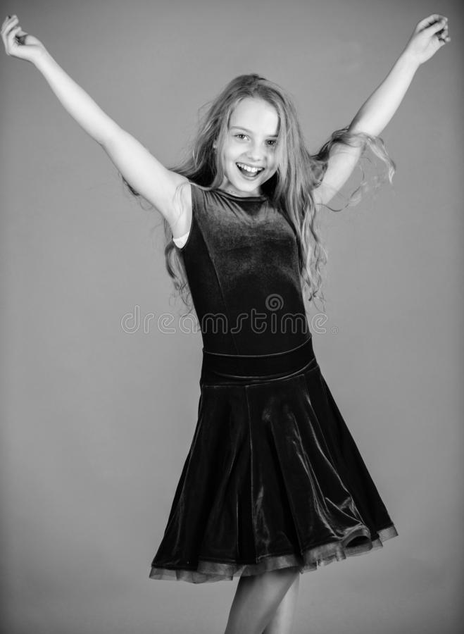 Kid dancer satisfied with concert outfit. Ballroom fashion. Girl child wear velvet violet dress. Clothes for ballroom. Dance. Kid fashionable dress looks royalty free stock photography