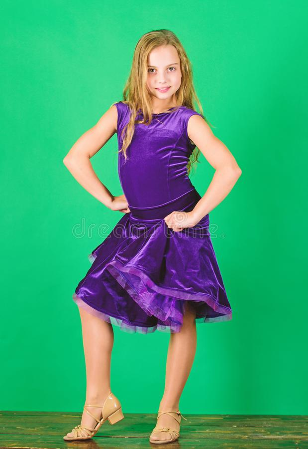 Kid dancer satisfied with concert outfit. Kids fashion. Kid fashionable dress looks adorable. Girl cute child wear. Velvet violet dress. Clothes for ballroom royalty free stock photo
