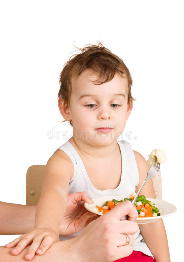 Kid does not want to eat salad stock image