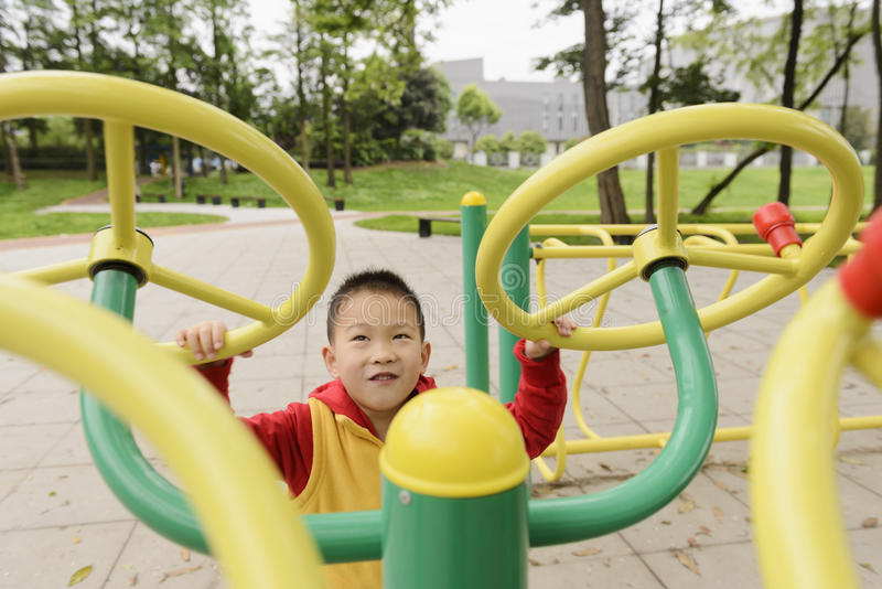 Kid doing exercise. Chinese kid doing exercise outdoor stock photos