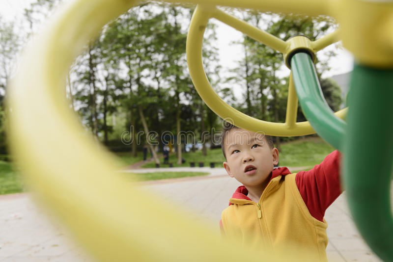 Kid doing exercise. Chinese kid doing exercise outdoor royalty free stock images