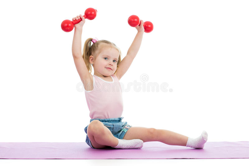 Kid doing exercises with dumbbells. Kid girl doing exercises with dumbbells stock photos