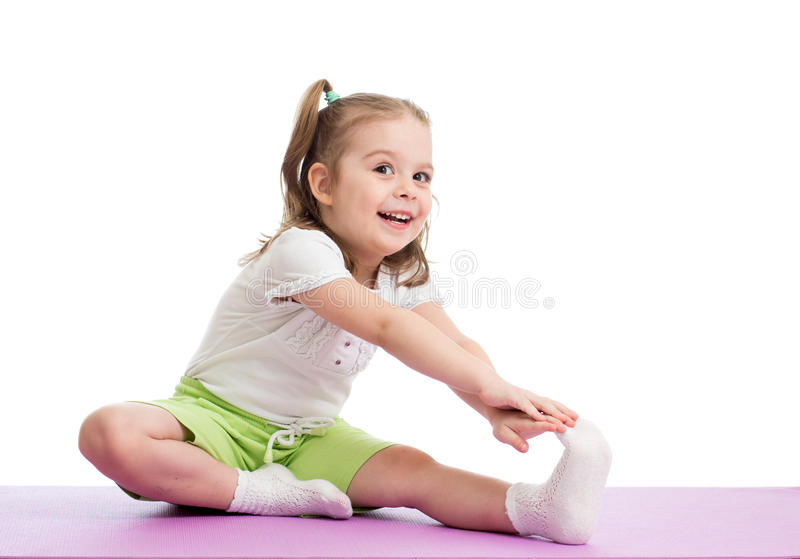 Kid doing fitness exercises. Kid girl doing fitness exercises stock photography