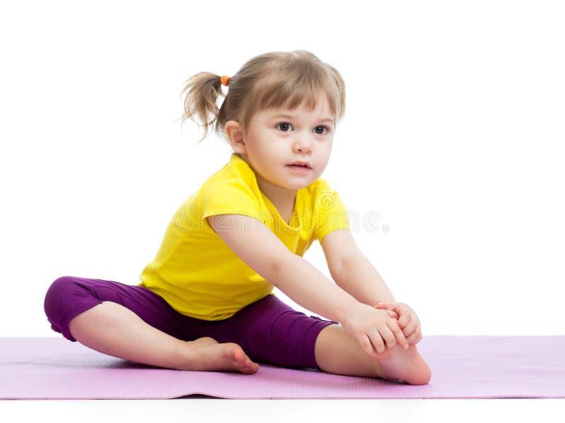 Kid doing fitness exercises. Kid girl doing fitness exercises royalty free stock image