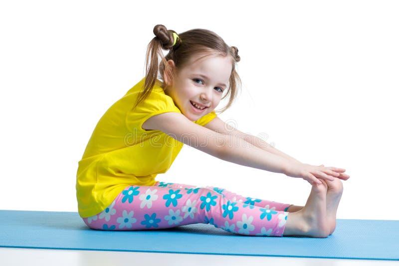 Kid doing fitness exercises. Isolated on white royalty free stock photo