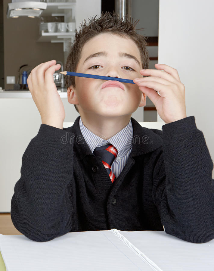 Kid Doing Homework At Home Stock Photography