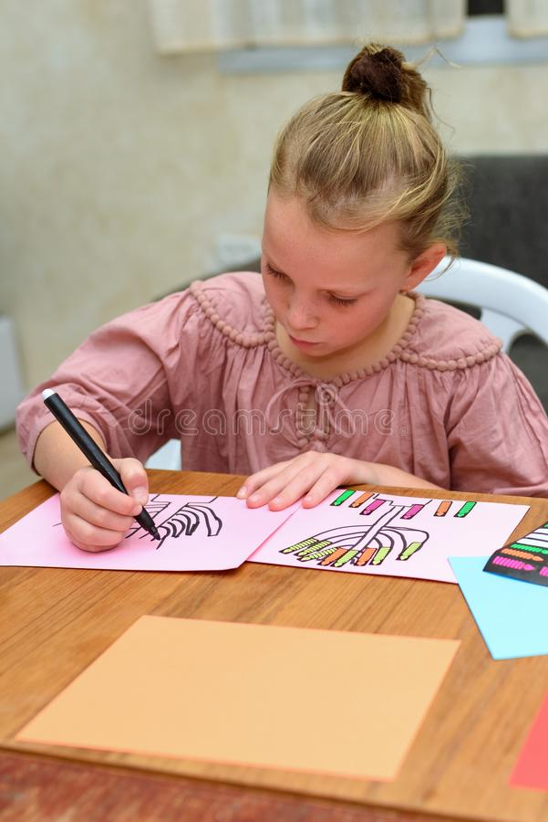 Kid Draw and Play With Stickers. Playing with stickers can help child on important developmental areas. stock images