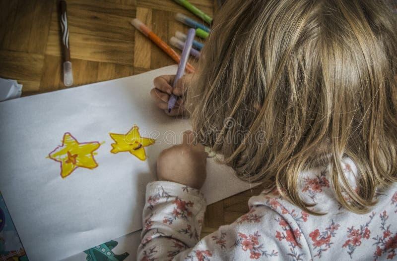 A Kid Drawing Stars stock image