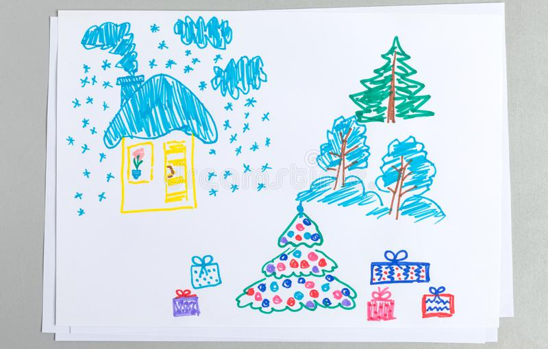 Kid drawing of winter Christmas and New Year scenes with covered with snow house and trees with gift boxes stock photos