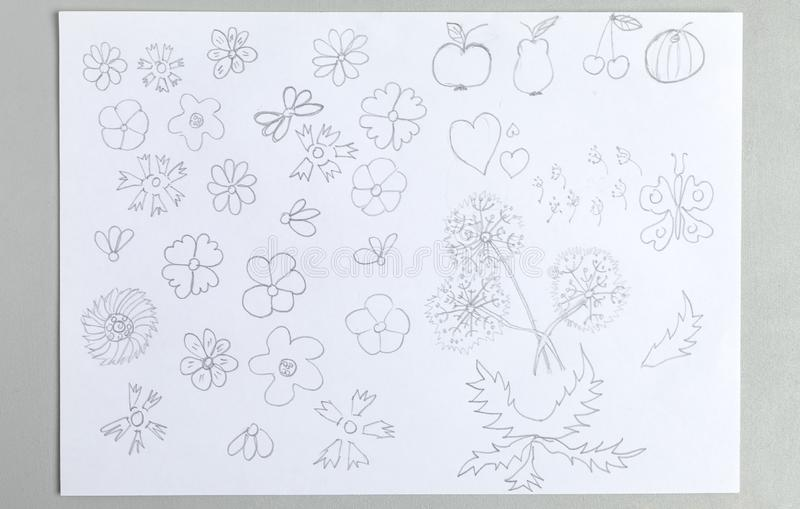 Kid drawings set of different flower heads fruits and butterfly royalty free stock photo