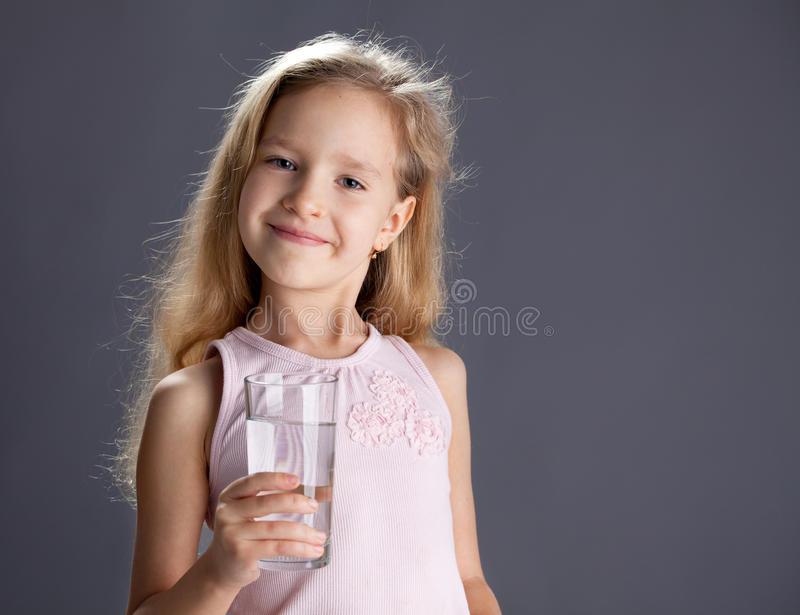 Kid drinking water from glass royalty free stock photos