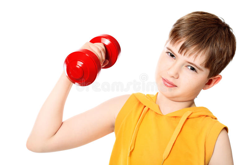 Kid with dumbbells stock image