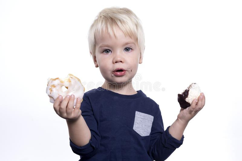 Boy with cakes royalty free stock photography
