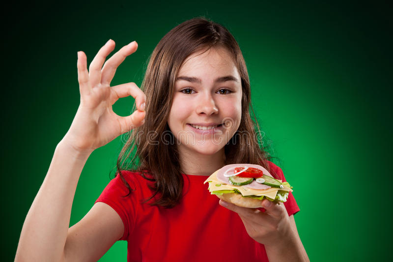 Kid eating healthy sandwiches royalty free stock images