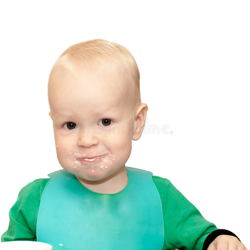 Kid is eating stock image