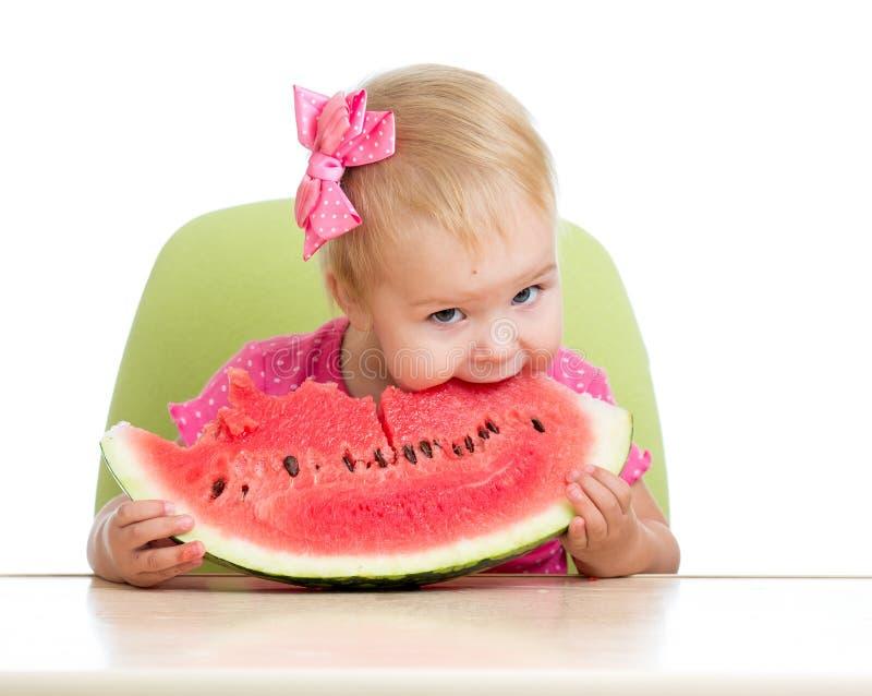 Kid eating watermelon on white royalty free stock photos