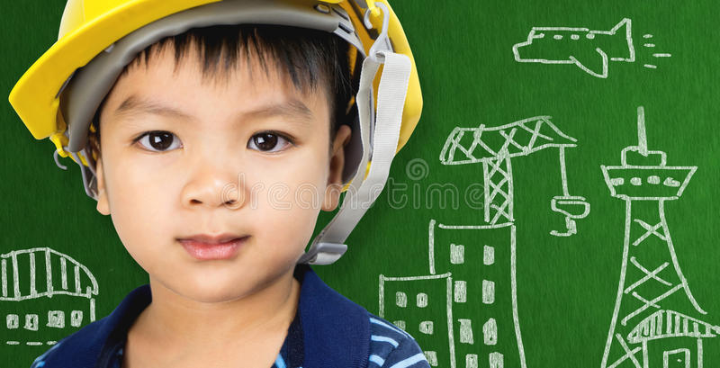 Kid with Engineering City building concept on blackboard stock photos