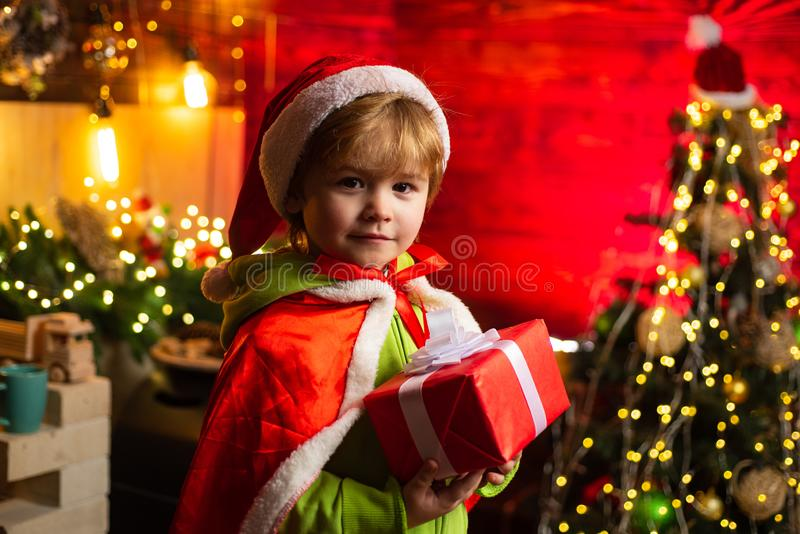 Kid enjoy winter holiday at home. Home filled with joy and love. Merry christmas and happy new year. Best wishes. Family. Holiday. Christmas gift. Cute little royalty free stock photo
