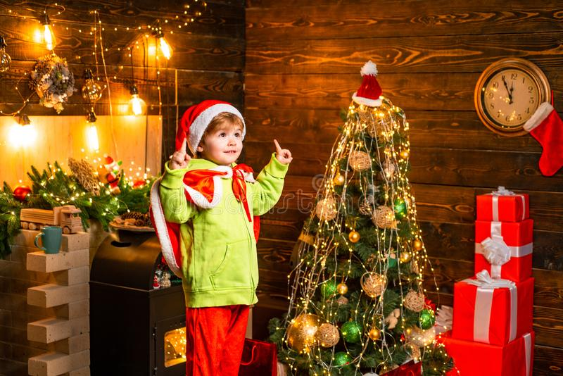 Kid enjoy winter holiday at home. Home filled with joy and love. Best wishes for you your family this christmas. Merry royalty free stock image