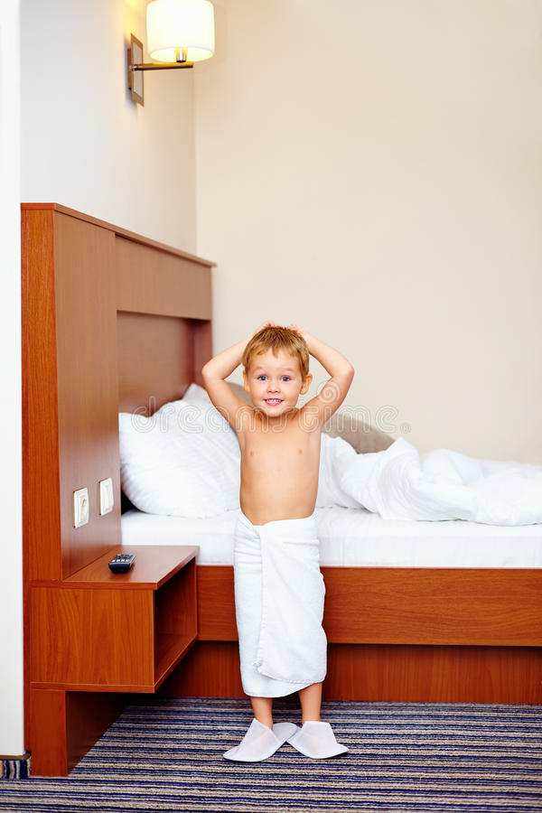 Kid Enjoying Hotel Room After Bathing Stock Photography