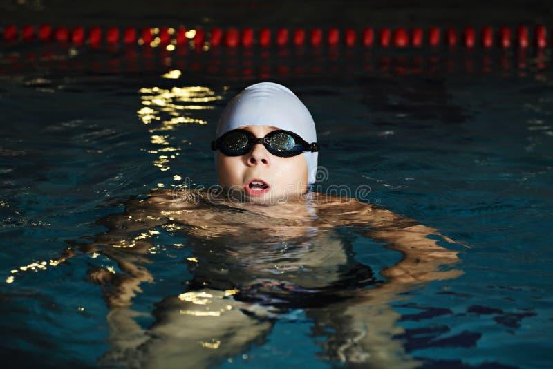 Kid enjoying swimming pool stock photos