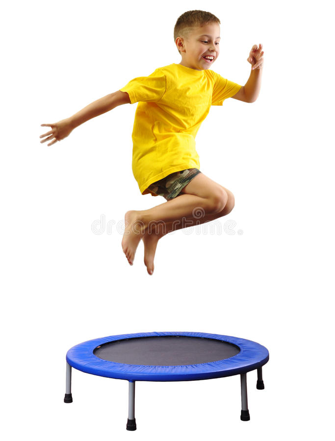 Kid exercising and jumping on a trampoline. Portrait of a cute sportive, cheerful happy kid jumping and dancing on batut. Childhood, freedom, happiness concept royalty free stock photo