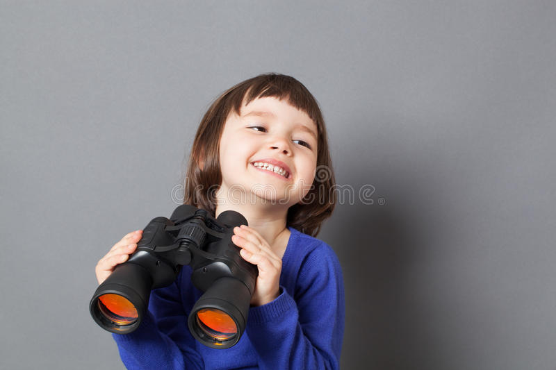 Kid exploration concept for excited 4-year old child. Kid exploration concept - excited 4-year old child with bob cut laughing in holding through binoculars for stock photography